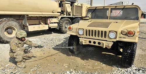 Army Cleaning 4x4 With Pressure Washer