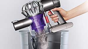Emptying Dyson vacuum into bin after cleaning stairs