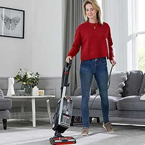 Woman Vacuuming With The Best Upright Vacuum