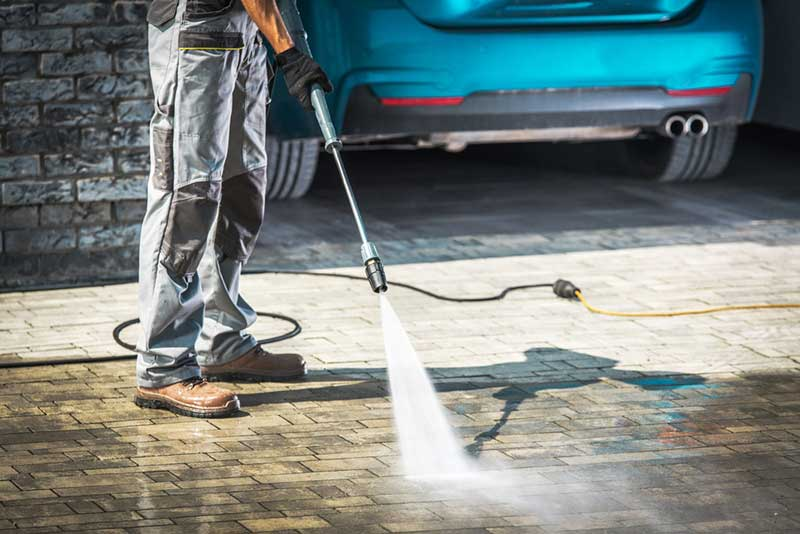 Man using a pressure washer