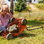 Person with broken lawnmower